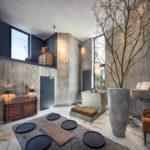 Innenraum in Sichtbeton mit Küche und Essbereich. Bild: Martin Baitinger / Focus