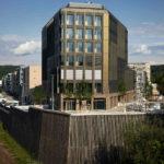 Holz-Hybrid-Hochhaus mit Solarfassade