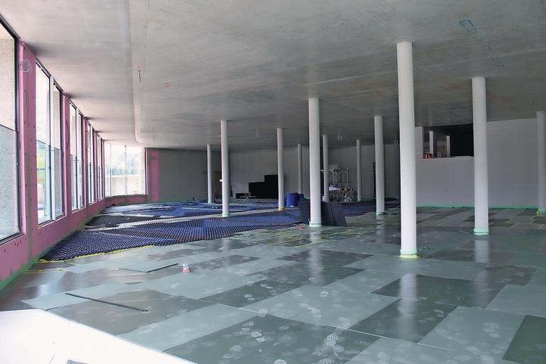 Bodenmatten werden im Rohbau ausgelegt. Bild: Getzner Werkstoffe GmbH