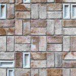 Besondere Verlegeweise der handgeformten Backsteine für eine plastisch wirkende Fassade. Bild: Mecanoo
