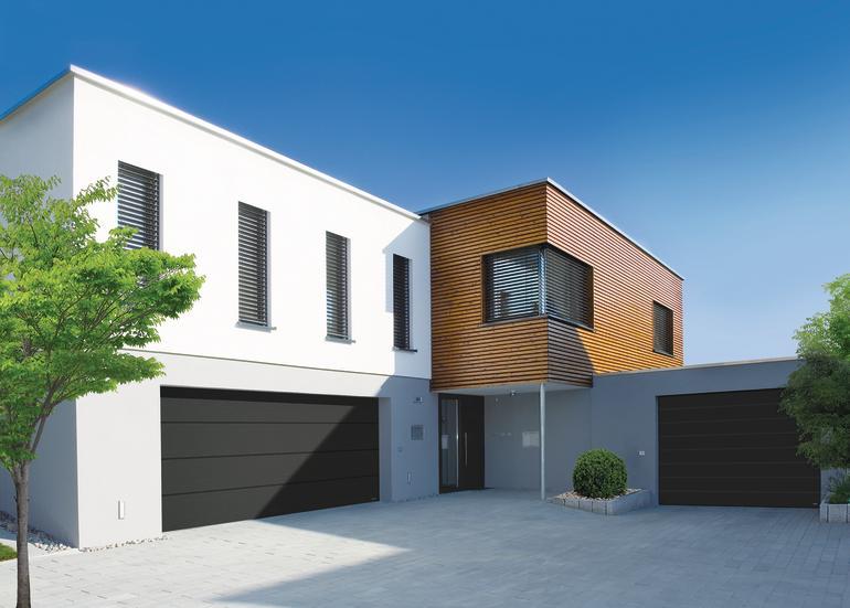 Zweistöckiges Wohnhaus mit Holzlamellen als Teil der Fassadengestaltung. Bild: Novoferm