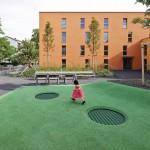 Urbane Nachverdichtung mit ökologischer Bauweise und anwohnerfreundlich gestalteten Außenanlagen.