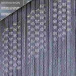 Licht- und Schattenspiele und die natürliche Patinabildung der Trapezprofile aus Titanzink verleihen der Fassade Lebendigkeit. Bild:Rheinzink
