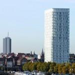 Mit einer Höhe von 87 m wurde der Wohnturm 2014 auf 37250 m² BGF fertig gestellt. Bilder: Lumecore – Toon Grobet