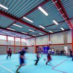 Sporthalle mit einer Decke aus Stahltrapezprofilen und mit Tageslicht dank Oberlichter. Bild: Daria Scagliola