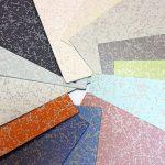Farbproben eines Bodenbelags. Bild: nora systems
