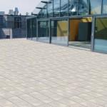 Steingraue Terrassen-Platten aus Keramik bilden die Grundlage für die weitläufige Dachterrasse.