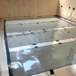 Carbonfolien bei der Verlegung einer Flächenheizung