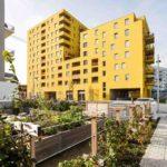 Wohnbauprojekt Nord 19 mit gelber Fassade vom Architekturbüro Superblock ZT GmbH