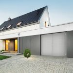 External_view_of_stylish_house_with_big_garage_and_stone_driveway