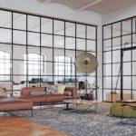 Loft mit großen Glaswänden, unterteilt von kleinen Quadratrahmen