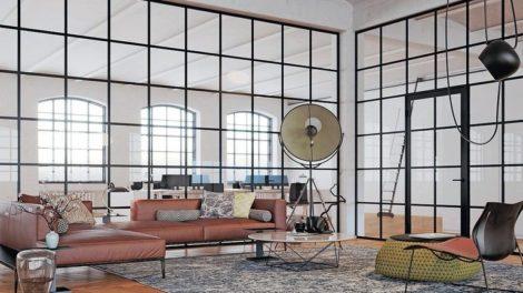 Loft mit großen Glaswänden, unterteilt von kleinen Quadratrahmen. Bilder: Goldbach Kirchner