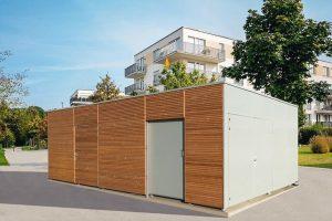 Einhausung passt sich optisch an Architektur an: Variobox von Käuferle funktioniert als Wertstoffsammelstelle, Fahrradabstellraum oder Carport. Bild: Käuferle