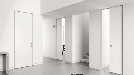 Zargen, die unsichtbar sind, für minimalistische Schiebetürsysteme: Eclisse Syntesis System besteht aus Einbaukästen für Schiebetüren ohne sichtbare Zargen. Bild: Eclisse