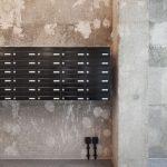 Die freigelegten Betonwände zeigen den ganzen urbanen Charme des Bestandsbaus. Bild: GBP Architekten / Anastasia Hermann