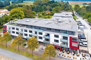 Bielefeld: Doppelt genutztes Wohngebäude mit Geschäftsbereich im Erdgeschoss. Bild: Firestone