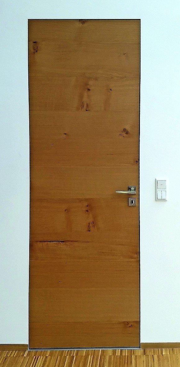 Reduzierte Zarge für wandbündige Türen. Bild: Wingburg