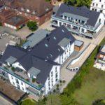 Blick von oben auf den Gebäudekomplex Cityhof Weyhe.