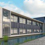 Gebäudemodell mit einer Fassade aus Sichtbeton, Glas und Vollholzprofilen.