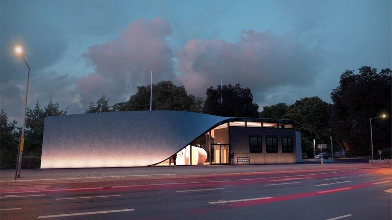 Grau geschwungenes Dach mit Carbonbewehrung unter Abendhimmel.